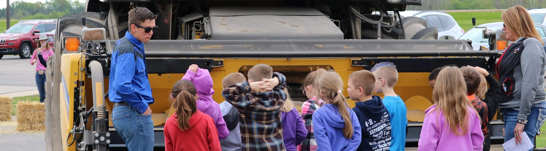 students observing farm implement